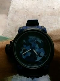 round black chronograph watch with black strap North Fort Myers, 33903