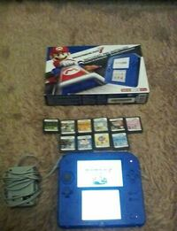 blue Nintendo DS with game cartridges St. Catharines, L2R 1P1