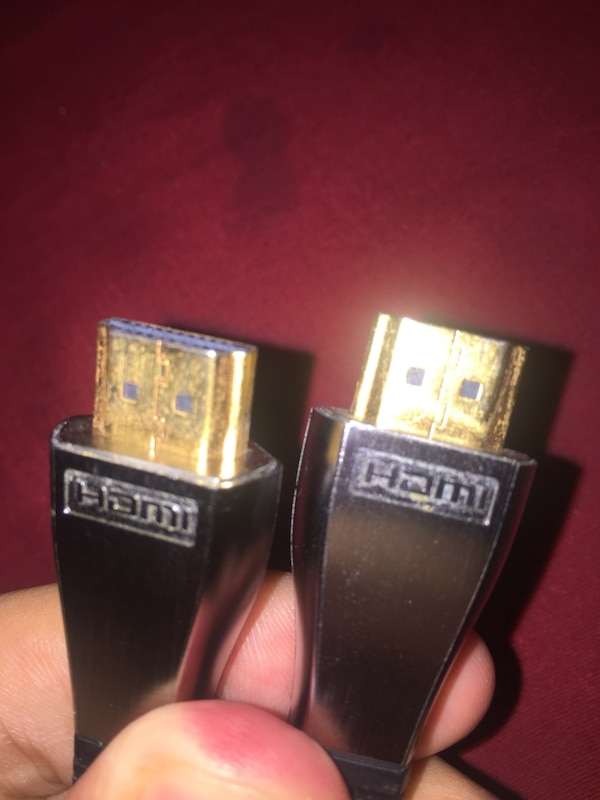 two black and gray flip lighters