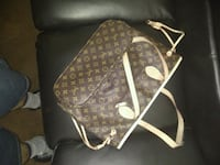 brown Louis Vuitton leather backpack East Point, 30344
