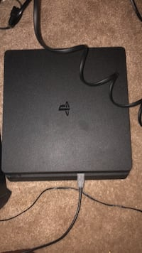Black sony ps4 slim with controller 1954 mi