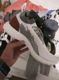 pair of white-and-black Adidas nmd sneakers size 9
