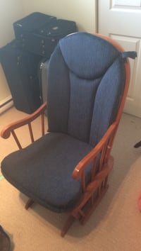 brown wooden padded glider chair