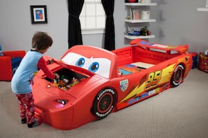 Convertible twin/toddler Cars bed with toy chest