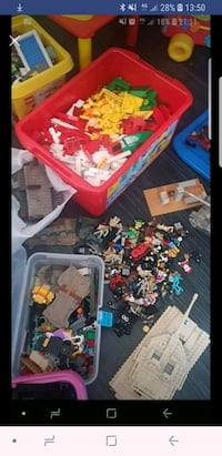 assorted plastic toys in box , TS25 2DY