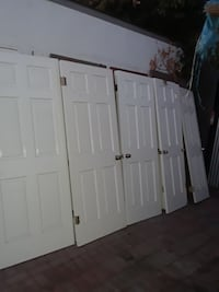 five white 6-panel wooden doors