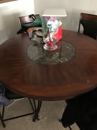 Round brown wooden pedestal table Ashburn, 20148