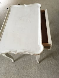 Antique white coffee table w drawer.