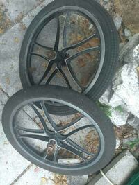"two black 20"" wheels with tires"