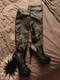 Pair of black leather heeled thigh-high boots Hamilton, L8K 1Z5