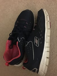 Pair of black nike running shoes 25 mi