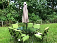 Rectangular black metal framed glass top patio table set