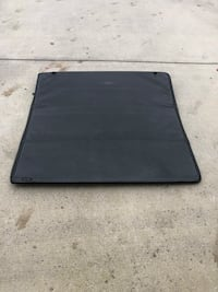"Tri-fold Truck bed cover measures 57"" x 57"" not sure what it fits, Nissan Frontier, Toyota Tacoma, Dodge,Ford Chevy s10 Colorado, gmc Sonoma  Knoxville, 37924"