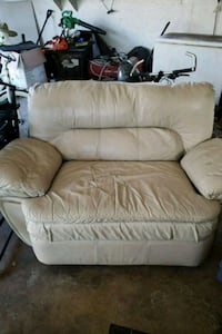 Tan, leather, reclining love seat (room for 2)