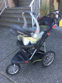 baby's black and red jogging stroller Surrey, V3X 3K9
