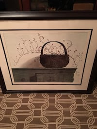 painting of brown wicker basket with black frame