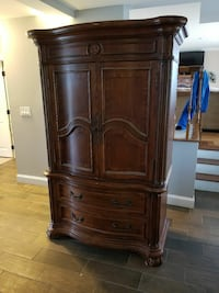 Solid wood armoire.