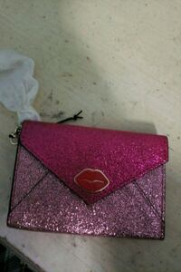 pink and black leather wristlet Ralston, 68127