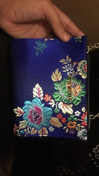 blue, green, and teal floral purse