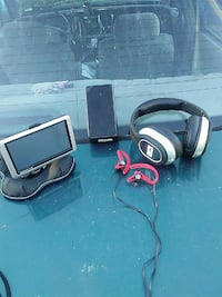 gray and black corded headphones and gray car GPS monitor