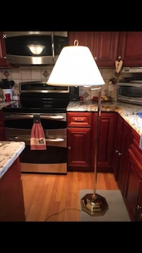 Three way adjustable swing arm floor lamp. In excellent condition well made heavy piece.   North Whitehall, 18037