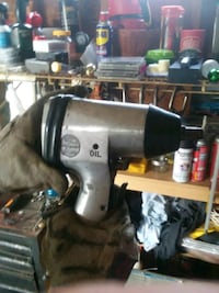 black and gray pneumatic impact wrench