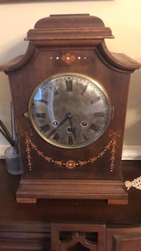 brown wooden framed analog clock Hagerstown, 21740