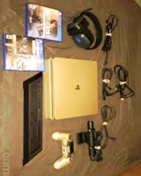 black Sony PS3 slim console with controller and game cases Washington