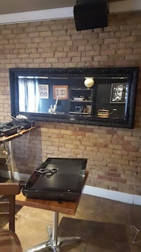 Black ornate frame wall mirror. Also have one in white Toronto, M9A 4S9