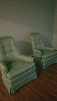 two gray-and-white polka-dot wing chairs