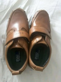 pair of brown leather slip on shoes Houston, 77084