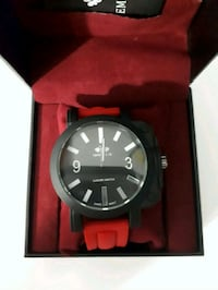 Round Black Analog Watch with red strap Milton, L9T 0G3