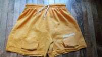 two yellow and white Nike shorts Minneapolis, 55419