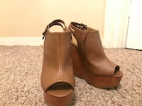 pair of brown leather open-toe wedge sandals