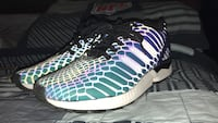 green, blue, and white Adidas ZX Flux running shoes
