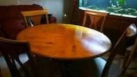 round brown wooden table with four chairs dining set Decatur, 30032