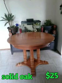 round brown wooden pedestal table Calgary, T2M 1V8