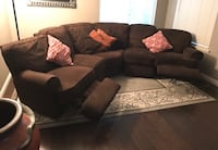 black fabric sectional sofa with throw pillows Oakland