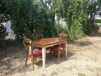 rectangular brown and white wooden table with four chairs dining set Kelowna, V1X 2H8