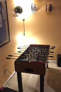 Brown and blue foosball table