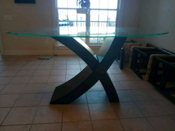 black wooden frame glass top table