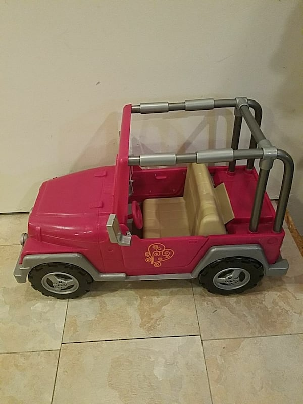 pink and gray ride-on toy Jeep Wrangler 6f0df4bc-4795-4be7-bea6-d375cf9aed40