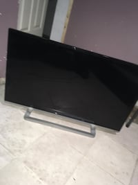 Black flat screen tv with remote New York, 11236