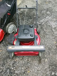 red and black push mower Foster, 02825