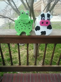 white and black wooden cow and green wooden frog bottle racks Fairhaven, 02719