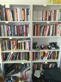 book lot filled in white wooden shelves Richmond Hill, L4C 9S5