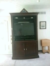 black wooden TV hutch White Lake charter Township, 48386