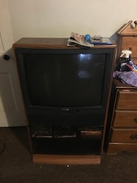 black CRT TV with brown wooden TV hutch Coshocton, 43812