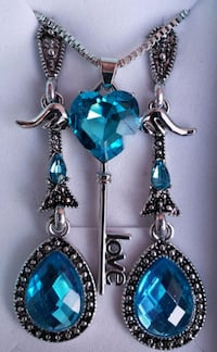 Sterling silver genuine blue topaz earrings and key necklace