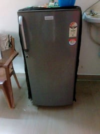 black and gray top-mount refrigerator